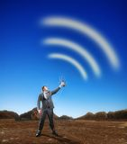 Businessman creating airwaves with antenna Stock Image