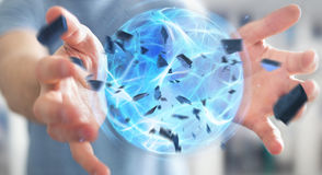 Businessman creating a power ball with his hand 3D rendering. Businessman creating an exploding blue power ball with his hand 3D rendering Stock Photo