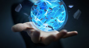 Businessman creating a power ball with his hand 3D rendering. Businessman creating an exploding blue power ball with his hand 3D rendering Royalty Free Stock Photos
