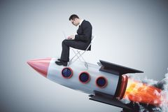 Startup and technology concept. Businessman on creative launching rocket. Startup and technology concept. 3D Rendering royalty free stock photo