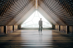 Businessman in creative wooden interior Stock Images