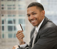 Businessman with credit card stock photography
