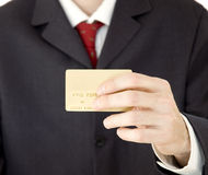 Businessman with credit card. Businessman holding a golden credit card Stock Photography