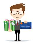 Businessman with a credit card and gift Royalty Free Stock Image