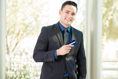 Businessman with a credit card Stock Photos
