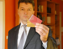 Businessman with credit cards Stock Photo