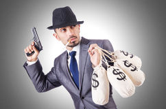 Businessman criminal. With sacks of money Royalty Free Stock Images