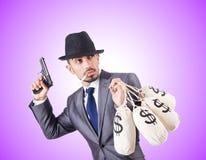 Businessman criminal with the sacks of money Royalty Free Stock Image