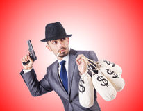 Businessman criminal with sacks of money Stock Images