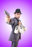 Businessman criminal with sacks of money Stock Images