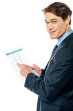 Businessman cross-checking annual report Stock Images