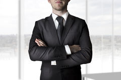 Businessman crossed arms Stock Image