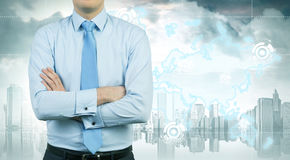 Businessman with crossed arms and gray city Royalty Free Stock Photos