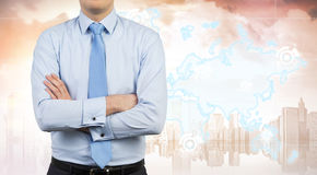 Businessman with crossed arms and pink city Royalty Free Stock Photo
