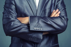 Businessman with crossed arms Stock Photos