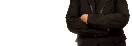 Businessman with crossed arms pose, with blank copyspace area fo Royalty Free Stock Photography