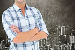 Businessman with crossed arms is standing on against cityscape drawing background. Digital composite of construction torso royalty free stock images