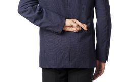 Businessman with crossed fingers on his back Stock Photo