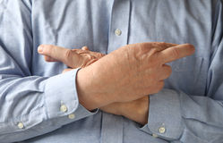 Businessman crosses his fingers and hands Stock Photography
