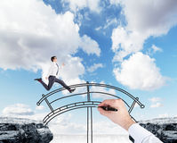 Businessman crossing a bridge Royalty Free Stock Images