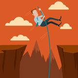 Businessman crossing the chasm. Stock Photo