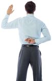 Businessman crossing fingers behind his back. On white background Stock Photo