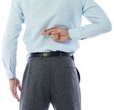 Businessman crossing fingers behind his back Royalty Free Stock Images