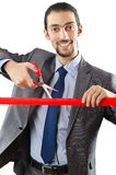 Businessman crossing finish line. On the white Stock Images