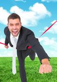 Businessman crossing finish line against sky and cloud Royalty Free Stock Image