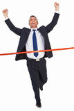 Businessman crossing finish line and cheering Stock Images