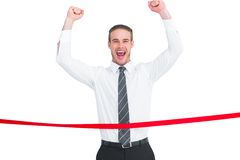 Businessman crossing the finish line and cheering Stock Images