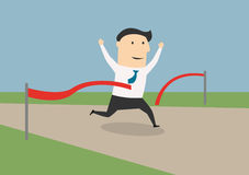 Businessman crossing the finish line Royalty Free Stock Image