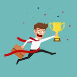 Businessman crossing finish line and holding trophy. Competition concept. Stock Image