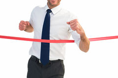 Businessman crossing the finish line Royalty Free Stock Photo
