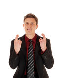 Businessman crossing his fingers. Royalty Free Stock Photo