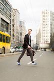 Businessman crossing the road in a hurry Stock Image