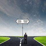 Businessman at crossroads Royalty Free Stock Image