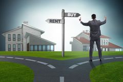The businessman at crossroads betweem buying and renting. Businessman at crossroads betweem buying and renting stock image