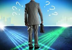 Businessman at crossroads Stock Image