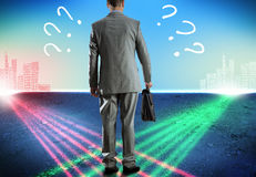 Businessman at crossroads Stock Photography