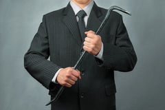 Businessman with crowbar Stock Photos