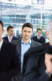 Businessman in crowd Stock Photos