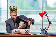 The businessman with crown and money sacks in the office Royalty Free Stock Images