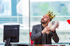 The businessman with crown and money sacks in the office Royalty Free Stock Photo