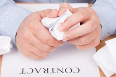 Businessman crumpling documents Stock Photo