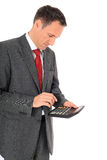 Businessman crunching numbers Royalty Free Stock Photography