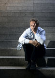 Businessman crying lost in depression sitting on street concrete stairs Stock Images