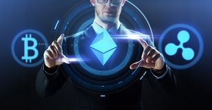 Businessman with at cryptocurrency icons royalty free stock photos