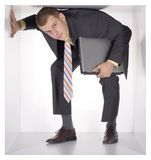 Businessman in the cube Stock Image