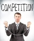 Businessman in cuffs with competition word Royalty Free Stock Photo